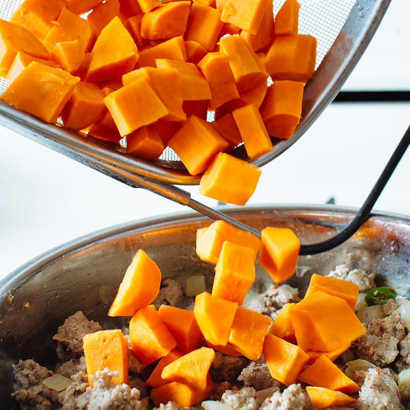 Add in cooked and drained sweet potatoes and stir to combine.